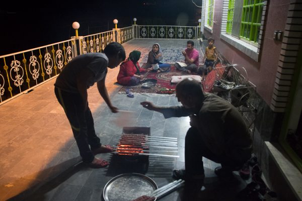 Azizi family preparing skewers of charcoal-grilled ground veal and mutton.