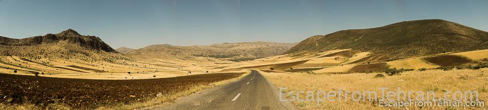 The flat areas along the road are covered with unirrigated wheat fields and herds of sheep and goats.