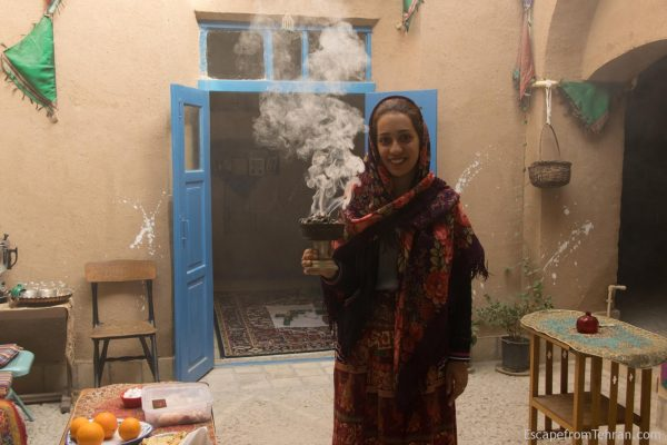 Tina Shohrat at Nartitee Ecolodge, cleansing the rooms with the smoke of sage and other herbs used by Zoroastrians.