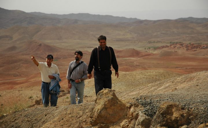 Iranian Men climbing toward Baba langar historical sites, near sabzevar, iran